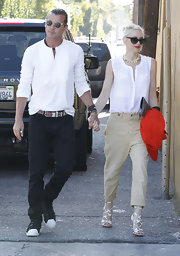 Gwen Stefani teamed her funky pants with a stylish sleeveless white blouse.