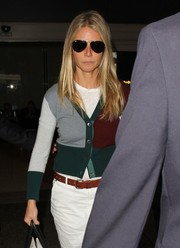 Gwyneth Paltrow looked serious wearing these dark Ray-Ban aviators as she arrived on a flight at LAX.