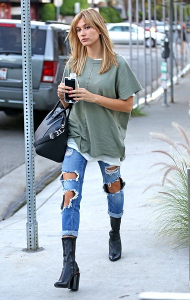 Hailey Bieber Ripped Jeans [clothing,street fashion,jeans,footwear,knee-high boot,snapshot,boot,fashion,knee,riding boot,jeans,jeans,trousers,hailey baldwin,errands,boot,fashion,boot,west hollywood,california,hailey rhode bieber,jeans,boot,ripped jeans,fashion,denim,trousers,shoe,t-shirt,mom jeans]