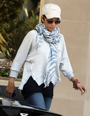 We are loving the cozy  deconstructed sweaters like Halle's.