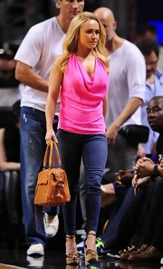 Hayden Panettiere sported this fuchsia cowl-neck top for her look while cheering on the Miami Heat.