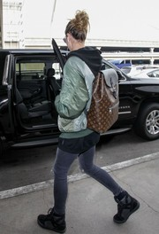 Heidi Klum was spotted at LAX carrying a cool Louis Vuitton backpack.