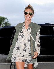 Heidi Klum arrived for her flight wearing a pair of mirrored green aviators.
