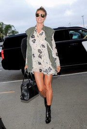 Heidi Klum went for a leggy airport look with this See by Chloe floral mini dress.