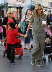 Heidi Klum wore this olive jumpsuit while out with her family in Century City.