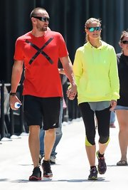 Heidi worked out in style when she sported this bright neon hoodie.
