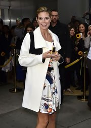 Heidi Klum promoted her fragrance in NYC wearing a midnight blue nail polish.
