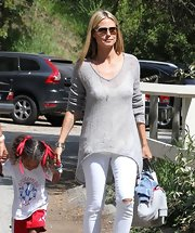 Heidi Klum stepped out at her kids' soccer game sporting an oversized V-neck sweater with an asymmetrical hem.