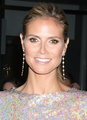 Heidi Klum's blonde locks looked sleek and straight when pulled back into this stylish high ponytail.