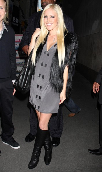 Heidi rocked a hot pair of black leather knee high boots with suede detailing.