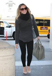 Hilary Duff dressed up her black skinny pants with nude pumps and oversized sunglasses while departing on a flight at LAX.