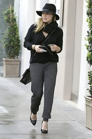 Hilary Duff topped off her casual shopping look with a floppy walker hat.