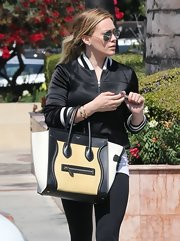 Hilary Duff chose a black satin zip-up jacket for her sport daytime look.