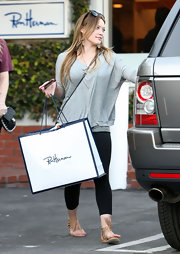 Hilary Duff went shopping in summery champagne Idalia Splatter Fringe sandals.