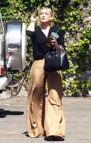 Hilary Duff punched up her look with a pair of super-flared gold pants.