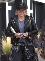 Hilary Duff stopped by the gym wearing a black baseball cap by Rise Nation.