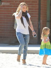 Hilary Duff chose a pair of skinny jeans with faded stars for her fun and youthful daytime look.