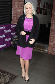 Holly Madison winterized a silky dress with a simple black pea coat.
