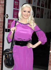 Holly Madison tamed a bright lavender dress with black accessories, including a supple leather purse.