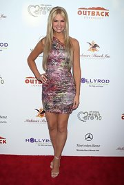 Nancy O'Dell paired her strappy gold sandals with a one-shoulder dress while hitting the red carpet.