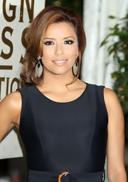 Eva looked sensational in her sparkling earrings. She paired them with a loose bun and simple black dress.