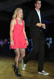 Bethanie Mattek-Sands channeled an 80s-era Madonna in her pink halter dress, tights, boots, and mussed-up hair.