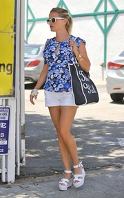 Reese Witherspoon completed her breezy outfit with white Hermes wedges.