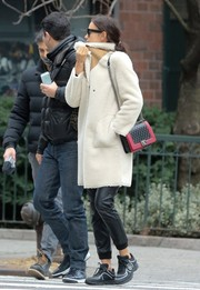 Irina Shayk kept warm in a white fleece coat while out and about in New York City.