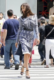 Irina Shayk did a photoshoot in New York City looking modern-chic in a mixed-print sheath dress.