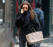 We are seriously coveting Irina's ecru leather tote.