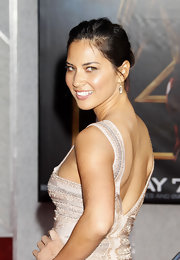 "Olivia went for simplicity at the ""Iron Man 2"" premiere. She paired her updo with a sleek Herve Leger dress."