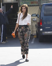 Isabel wears a long floral skirt while out and about shopping.