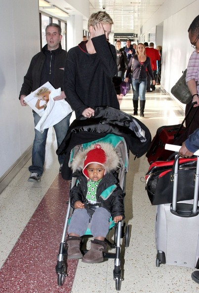 Charlize Theron And Son Arriving at Logan Airport
