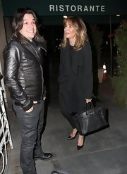 Jaclyn Smith bundled up in a black wool coat while out getting dinner in Hollywood.