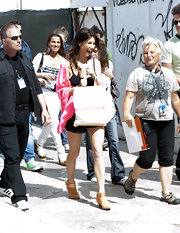 Jacqueline MacInnes Wood paired chic studded tan ankle boots with her camisole and shorts combo while filming in Italy.