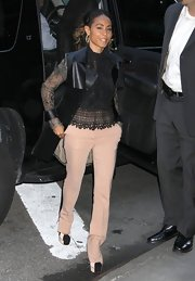 Jada Pinkett Smith chose a long leather vest to pair over her lace top for a cool mix of textures.