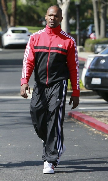 Jamie Foxx looked ready for a busy day in a red track jacket and athletic pants.