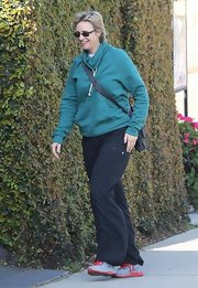 Jane Lynch looked comfy and casual in a teal pullover hoodie while out in California.