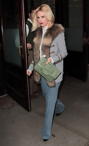 January Jones carried this sage envelope clutch out in NYC.