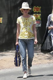 January Jones spored a white and yellow eyelet top while out getting lunch.