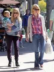A pink plaid button down gave January Jones a hint of country flare while out with her son, Xander.