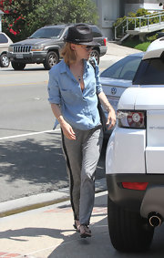 An slightly unbuttoned chambray shirt made January Jones stylish without even trying.