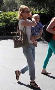 January Jones carried all of her mommy essentials in a light taupe Chanel quilted chain strap tote.