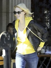 January Jones mixed casual and cool with a bright yellow sweatshirt and edgy motorcycle jacket.