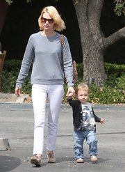 January Jones opted for a pair of white skinny jeans for her daytime look while out with her son, Xander.