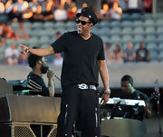 Jay-Z keeps it cool in a black v-neck tee.