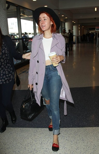Jena Malone sported a stylish lavender trenchcoat while catching a flight.