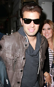 Jencarlos Canela was spotted walking the streets of New York in classic Ray Ban Wayfarer sunglasses.