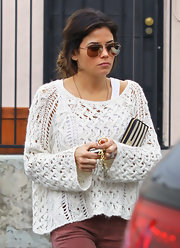 Jenna Dewan-Tatum warmed up in a cropped loose knit sweater layered over a basic tank.
