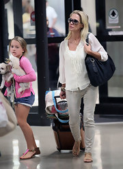 Jenni Garth was spotted at LAX in a pair of gray washed jeans with a delicate cheetah print.
